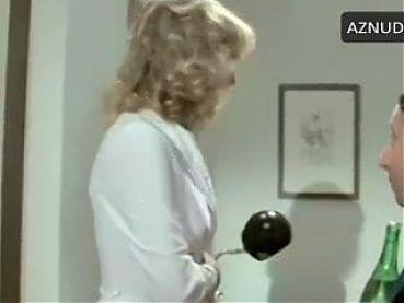 A. M. Rizolli in white satin bikini panties in 1979 movie